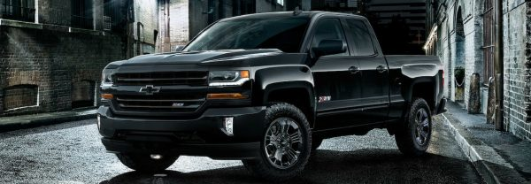 2019 Chevy Silverado 1500 midnight edition parked in alley way