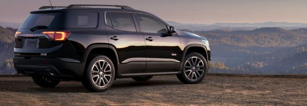2019 GMC Acadia parked on a hillside overlook