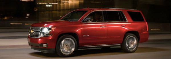 2019 chevrolet tahoe driving through the city